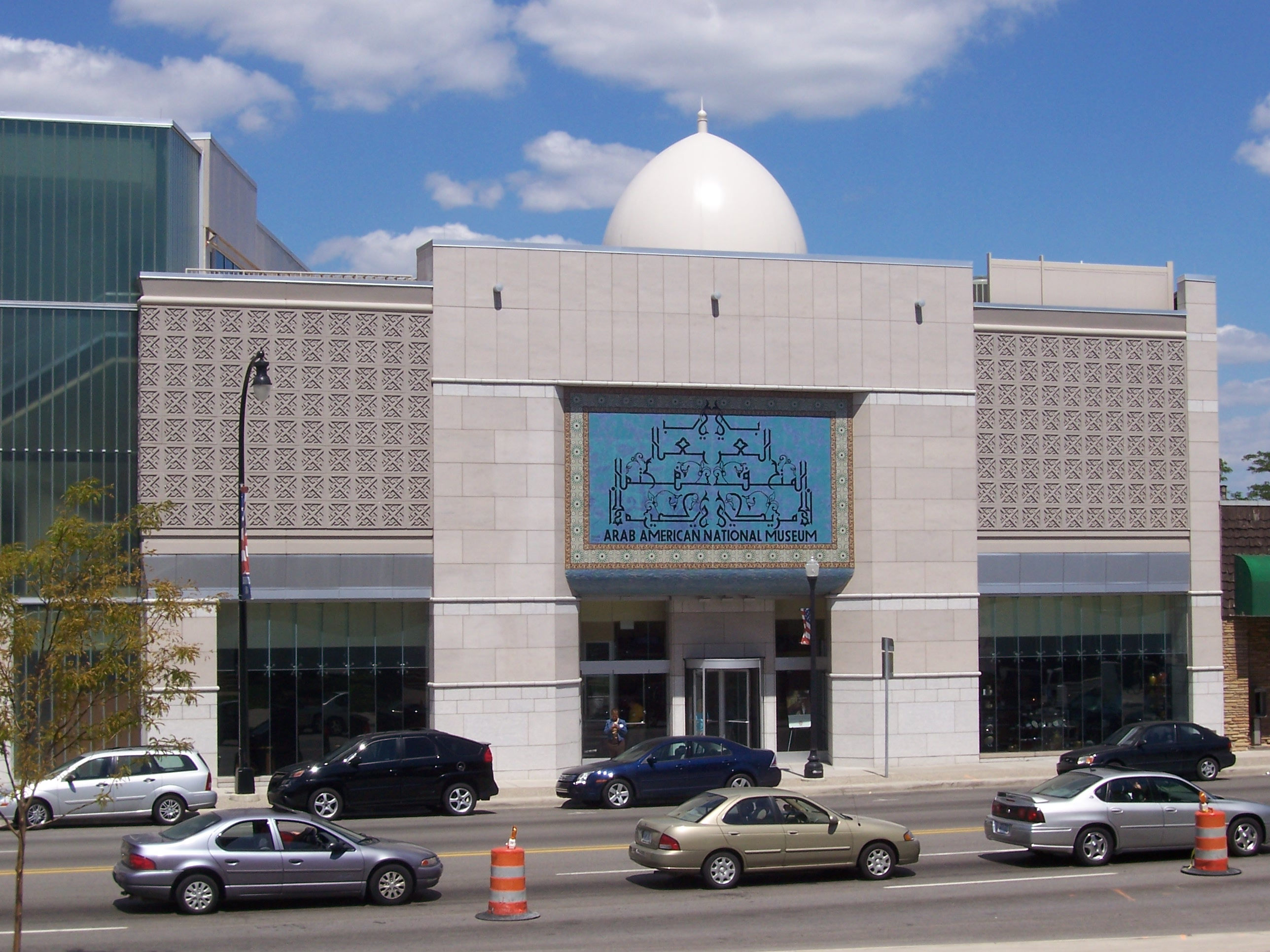 The Arab American National museum facade made of white stone with a dome